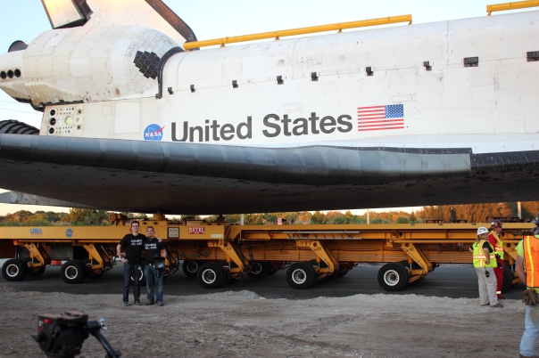 Beneath the wing of Atlantis during her final roll-out