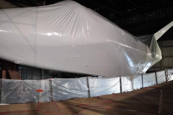 Atlantis In Shrink Wrap being prepared for New Facility cr. Ryan Kobrick
