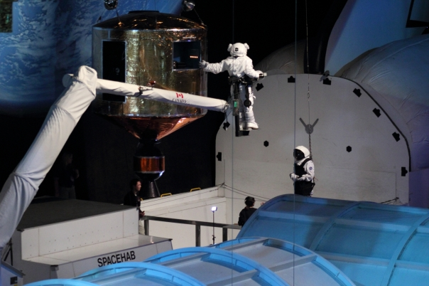 Astronaut Abby performs a simulated satellite repair on the Canadarm