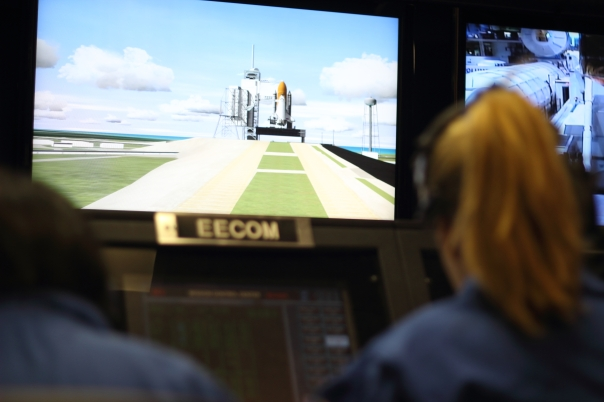 "Astronaut Abby and her team ""Liberty Bell"" prepares for liftoff from Mission Control Simulation Room at Space Camp"