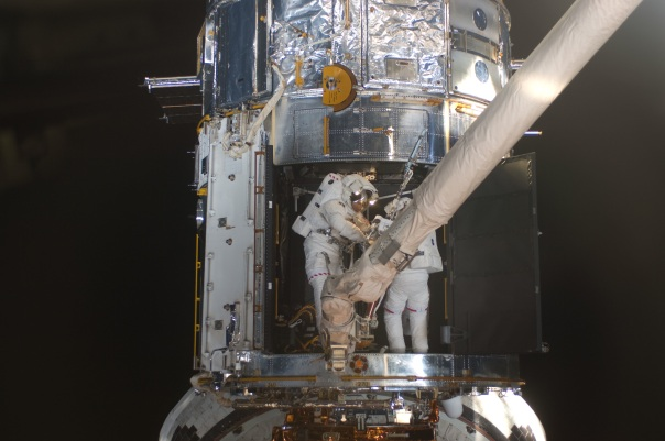 Crew of STS-125 on 4th Extra Vehicular Activity to service Hubble May 2009