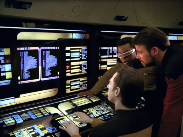 Data, Geordi, and Riker at one of many LCARS based terminals on the bridge of USS Enterprise D