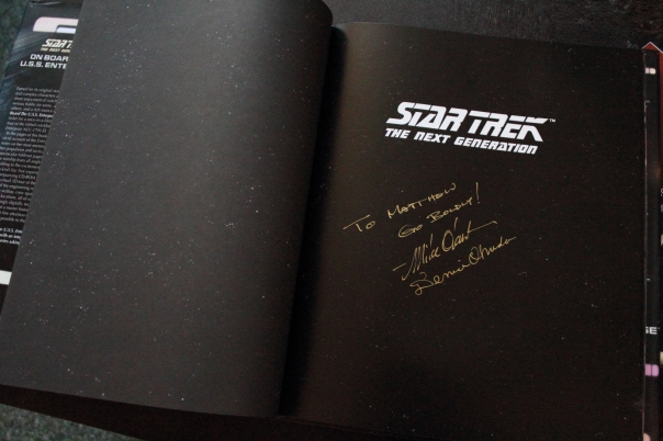 On Board the USS Enterprise Autographed by Michael and Denise Okuda.