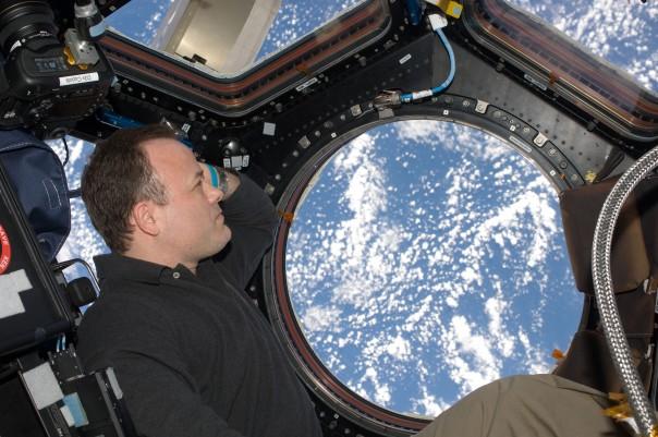 Ron Garan peers at Earth from the ISS Credit: NASA