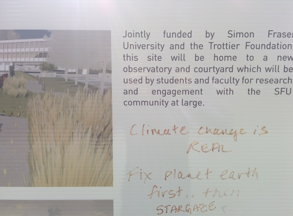 """Graffiti"" at the Trottier Observatory at Simon Fraser University reads: Climate Change is Real. Fix Planet Earth First..then Stargaze"""