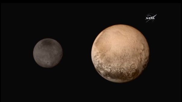 Pluto (right) and its moon Charon (left) shot by New Horizons  July 13th 2015